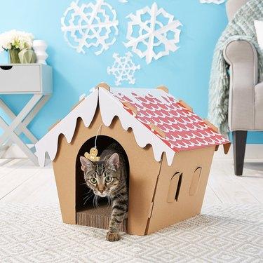 cardboard cat scratcher shaped like gingerbread house