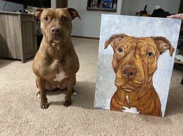 dog sitting next to its custom portrait