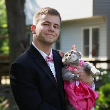 Guy and his cat prom date