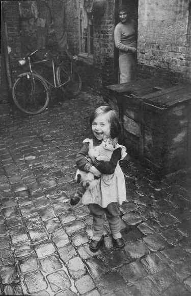 Old time picture of a girl with a cat