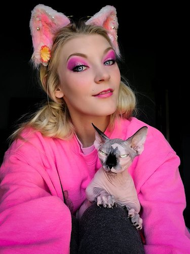 woman posed with hairless cat