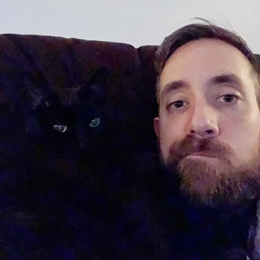 selfie with black cat foiled by black couch