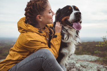 Young woman with dog outdoors