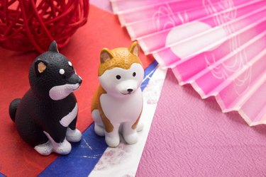 New Year image 'Dog's Figurine' and 'Fan'