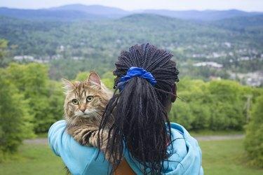 Human and animal Contemplation on Mountain Peak