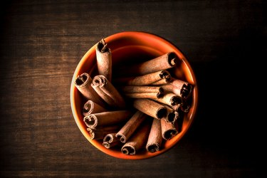 High Angle View Of Cinnamons In Bowl On Wooden Table