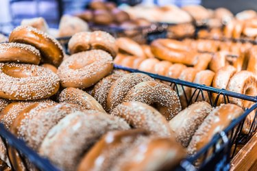 Closeup of many bagels in bakery