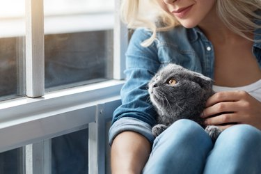 Close up of blond lady with cat