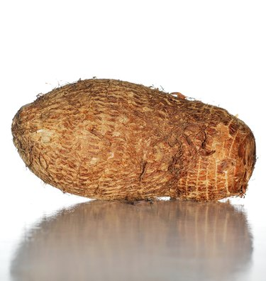 Yam on a white surface with white background.