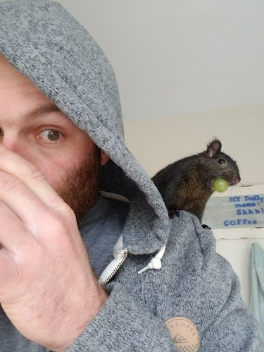 Man with squirrel sitting on his shoulder