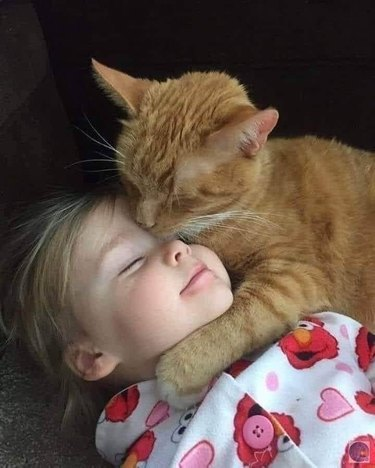 black cats cuddles with girl