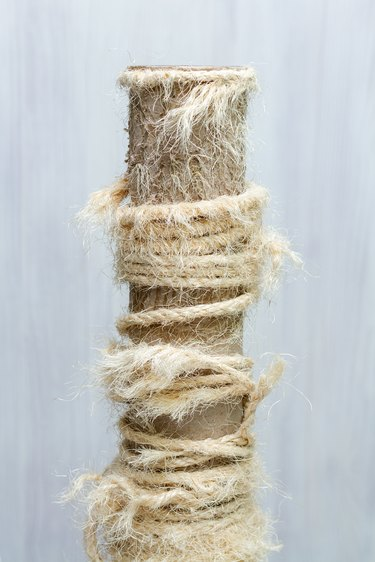 old cat tree, used scratching post with torn ropes