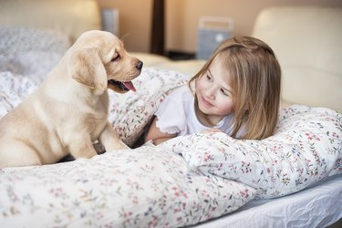 She loves to share a bed with her best friend -dog