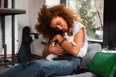 Cat lover holding cat