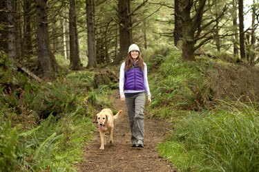 Female hiking with her dog.