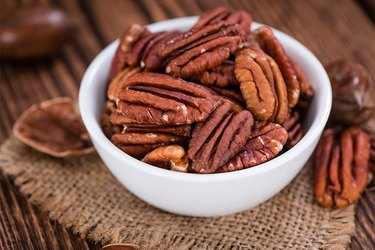 A bowl of pecans on a table