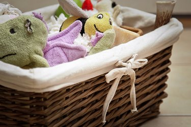 Keep from tripping over Fido's toys by organizing them into a basket.