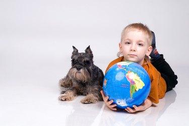 the boy, globe and a dog