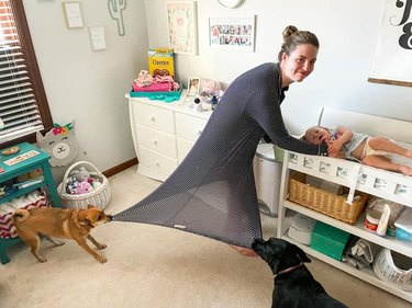 dog pull on woman's dress