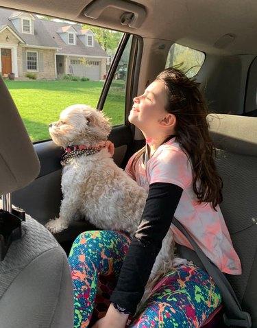 dog and human enjoy open window