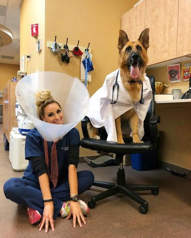 Veterinarian in cone of shame and dog in doctor's coat pose for Halloween image