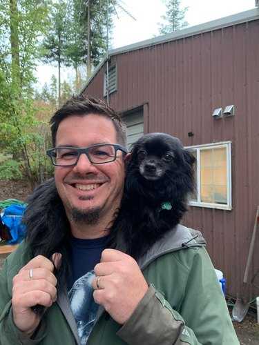 dad who didn't want dog loves newly adopted dog