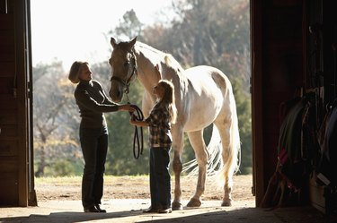 mother and daughter with horse