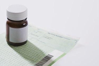 Pill bottle on doctors prescription