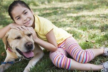 Girl embracing dog