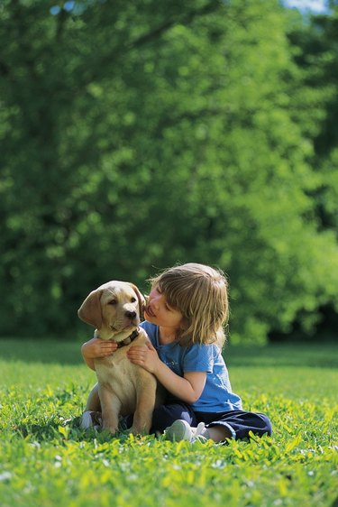 Girl with puppy , outside
