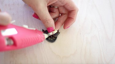 Gluing the shrink charm to a blank pin