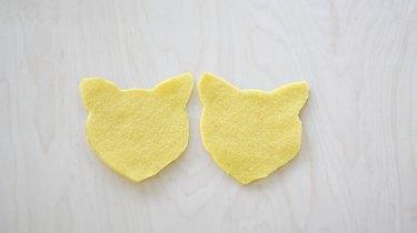 Two felt head shapes