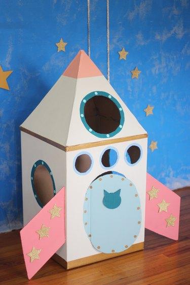 Finished cardboard cat rocket ship