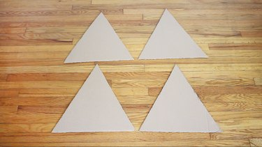 Four cardboard triangles cut out