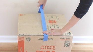 taping bottom of box shut