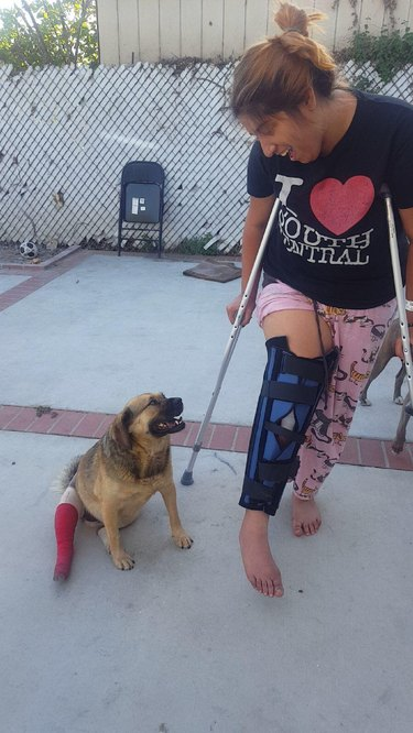 Woman and dog with matching injured legs.