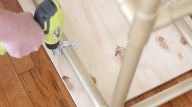 Drilling screws into pipe straps