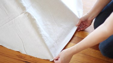 Folding raw edges to create a cleaner hem