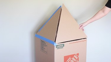 Taping triangles to top of box