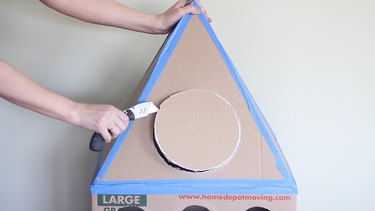 Cutting out round window on top of box