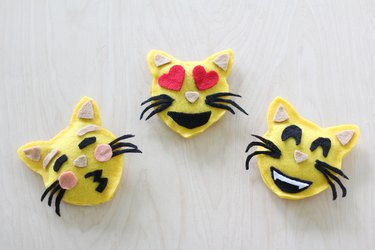 Three emoji catnip toys
