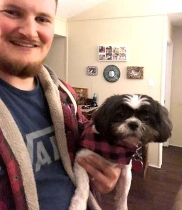 Man and dog in matching red plaid flannel
