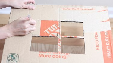 cutting window out on side of box
