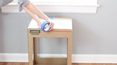 taping top of box shut