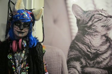Girl cosplays as cat at CatCon 2015