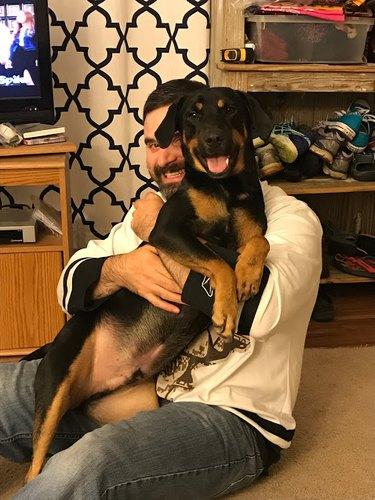 Steve holding Rocky the dog.