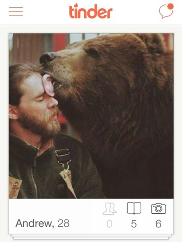 Grizzly licks mans face in Tinder picture
