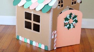 Paper gumdrops lined along bottom of house