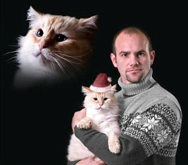 Man posing for picture with his cat