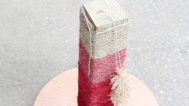 attaching pom-poms to scratching post